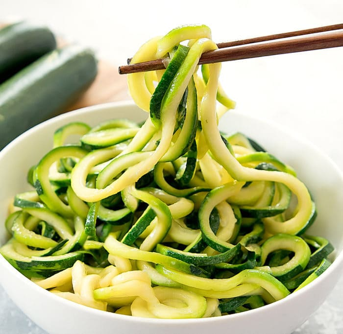 photos of chopsticks grabbing Garlic Zucchini Noodles