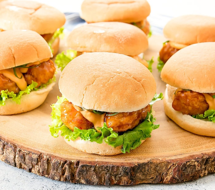 general tso's chicken sliders on a wooden serving board
