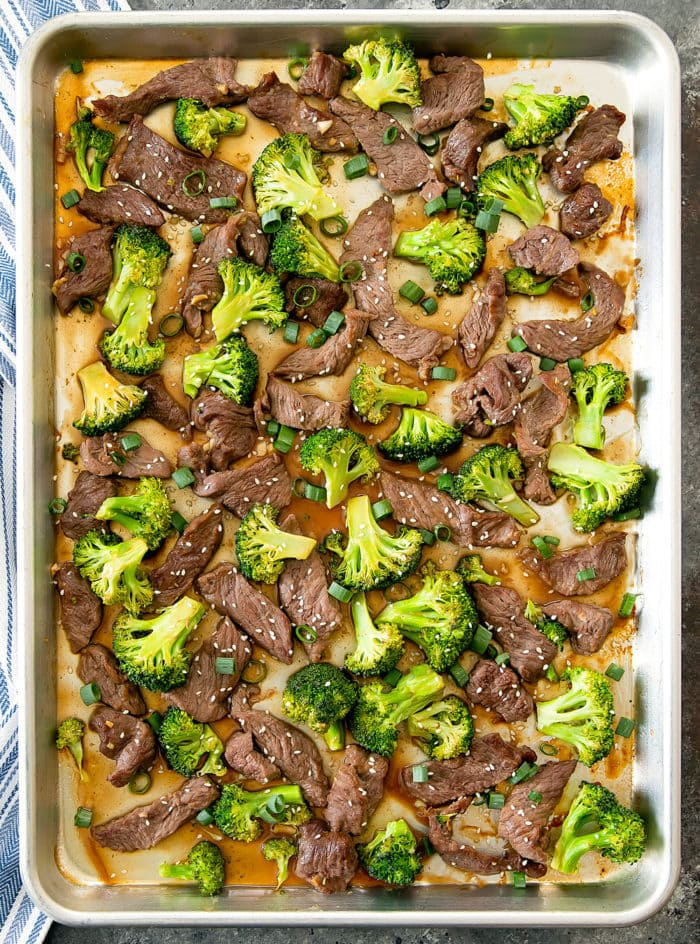 overhead shot of beef and broccoli on a sheet pan