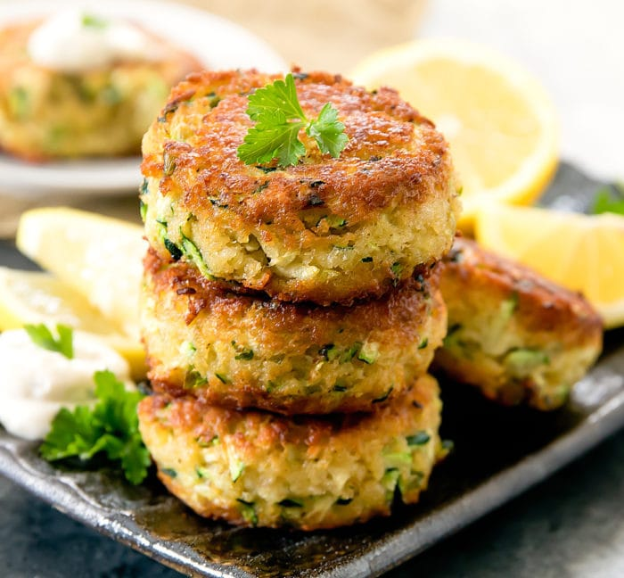 "a photo of a stack of Zucchini ""Crab"" Cakes"