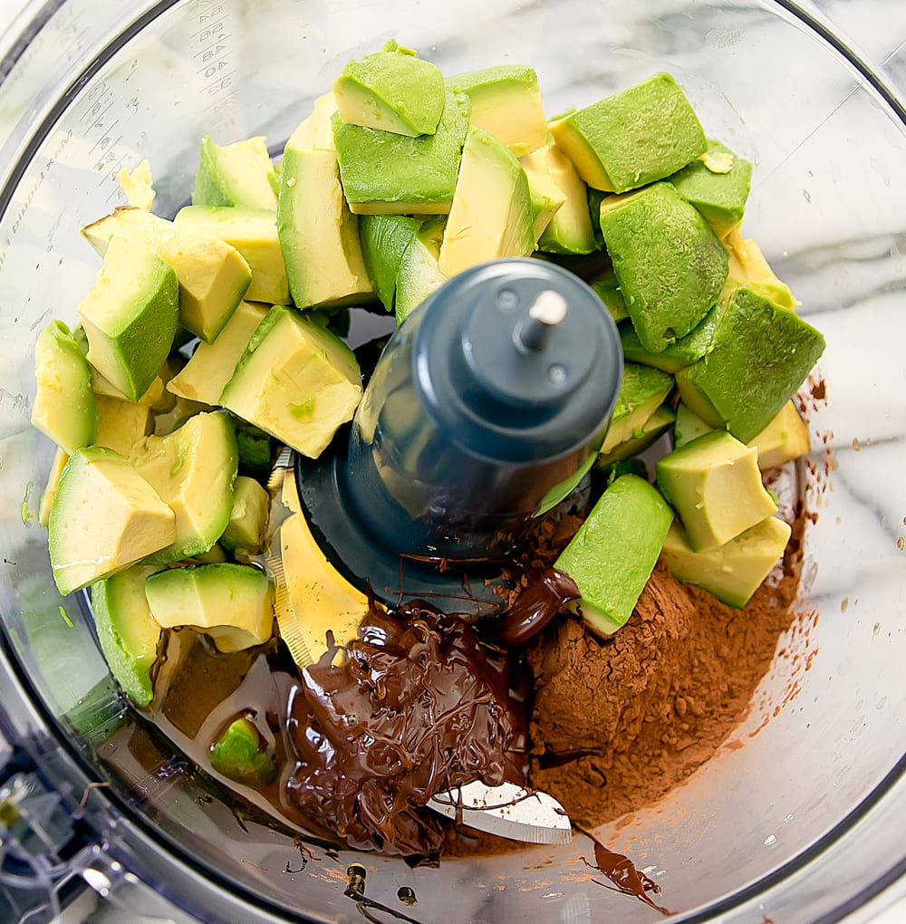 step by step photo showing ingredients in a food processor