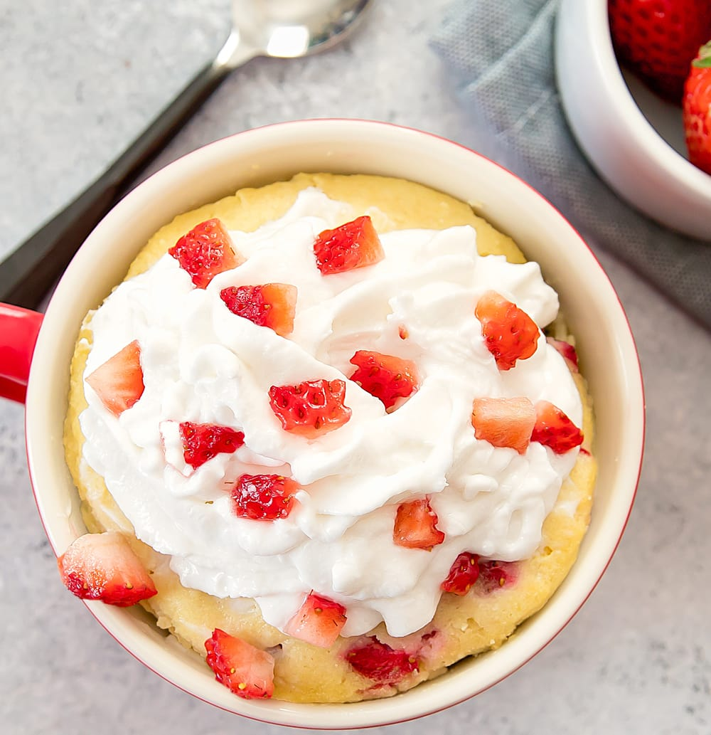 overhead photo of Strawberries and Cream Mug Cake