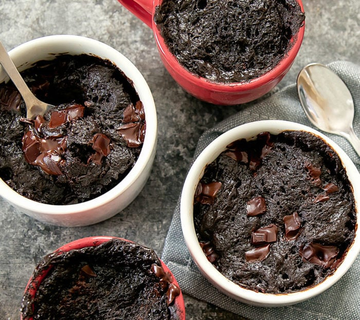overhead photo of four Flourless Nutella Brownie Mug Cake