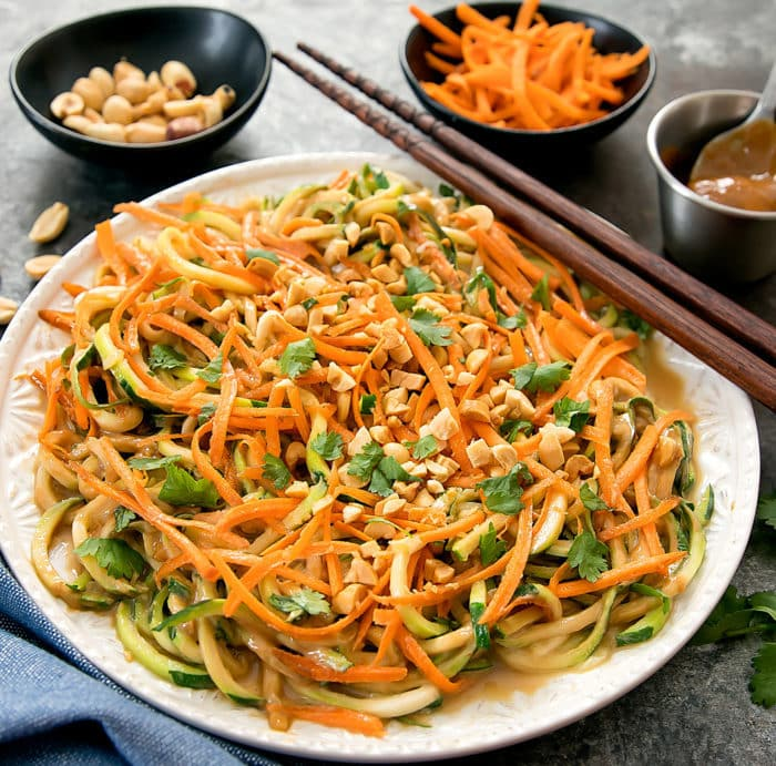 photo of Thai Peanut Zucchini Noodles on a plate with chopsticks