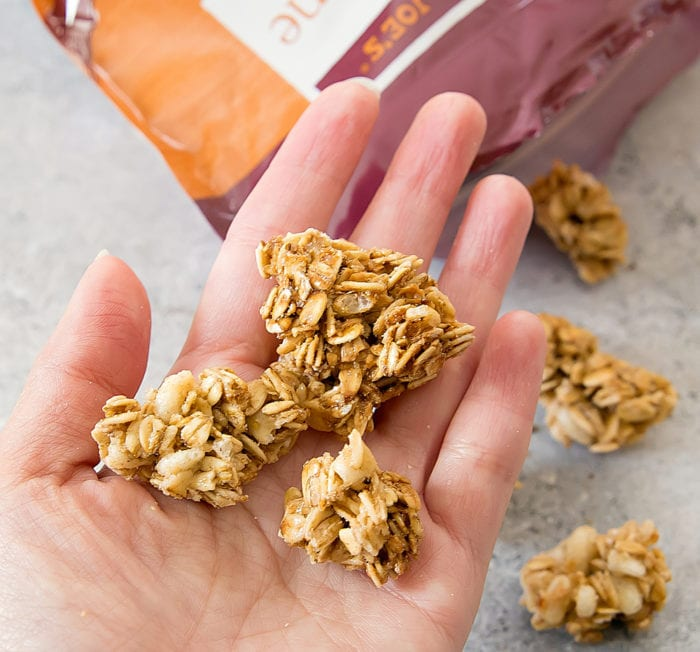 photo of a handful of Pecan Praline Granola
