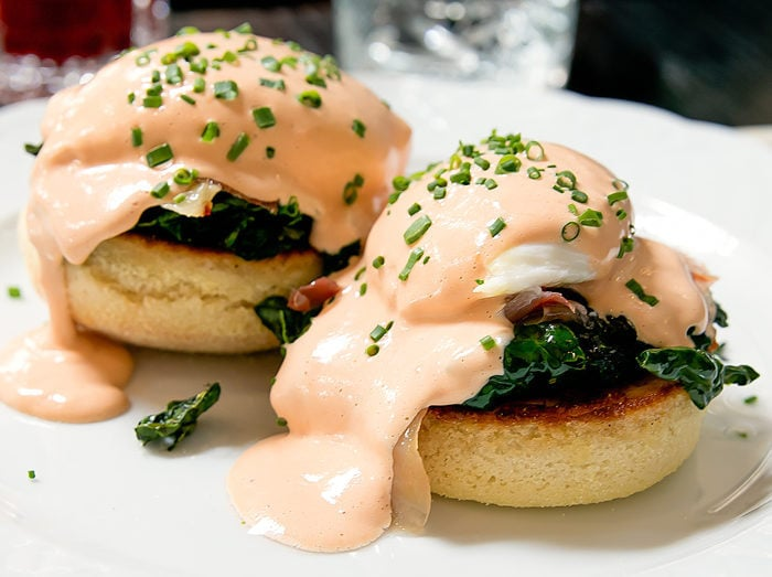 photo of Jamon Iberico Benedict, English Muffin, Poached Eggs, Braised Kale, Smoked Tomato Hollandaise