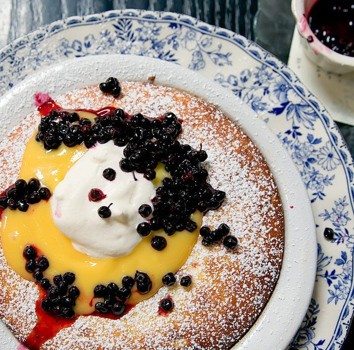 photo of Dutch Baby Soufflé Pancake, Huckleberry, Lemon Curd, Vanilla Chantilly at Herb and Wood