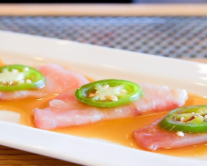 photo of a plate of Hamachi Sashimi