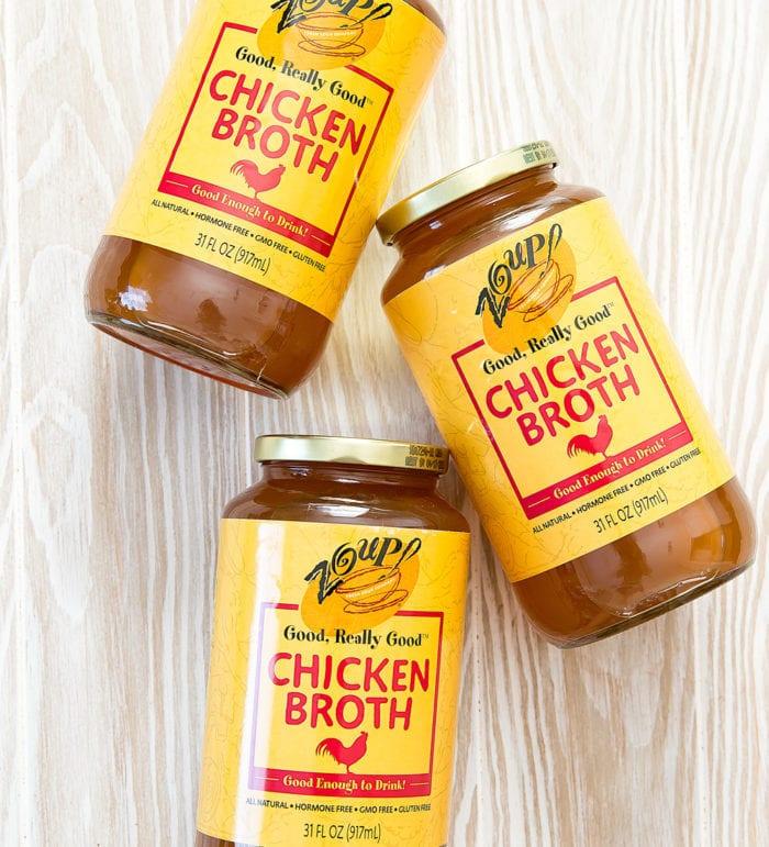 overhead photo of three jars of Zoup! chicken broth