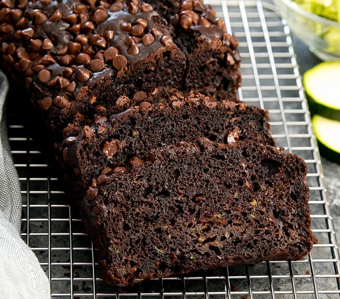 a close-up photo of sliced chocolate zucchini bread