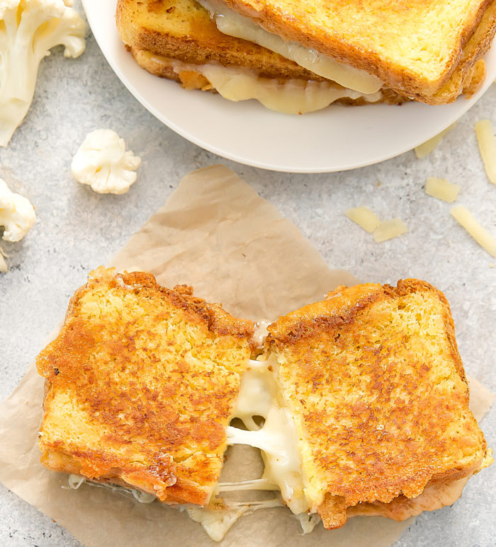 overhead photo of a Cauliflower Grilled Cheese sliced in half