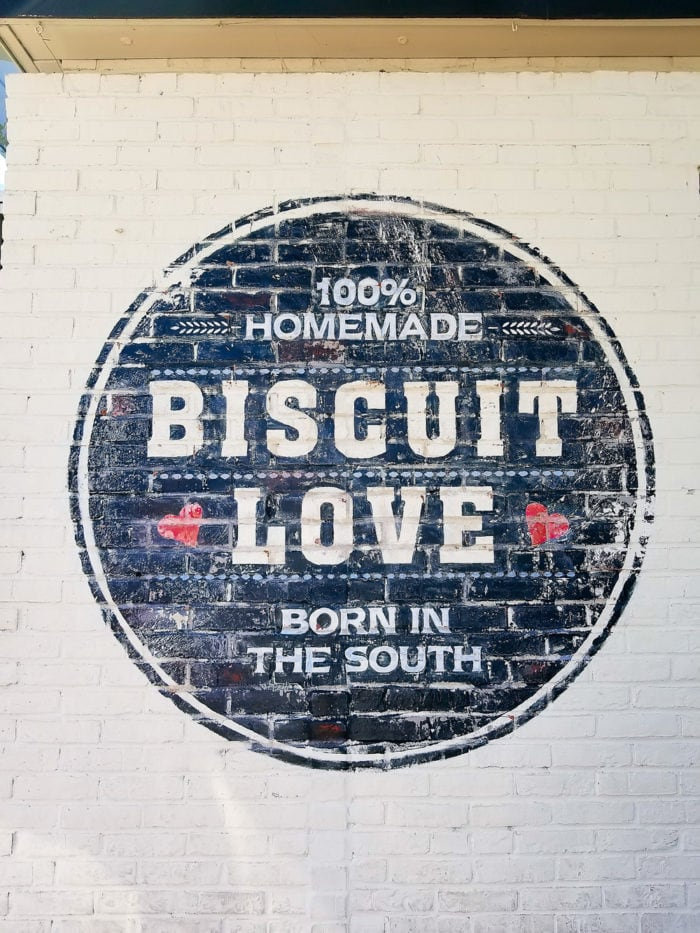 photo of the logo painted on a brick wall