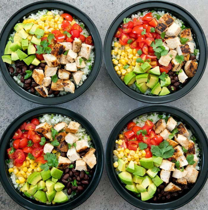 overhead photo of four burrito bowls