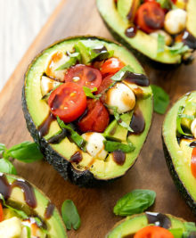 photo of a caprese stuffed avocado
