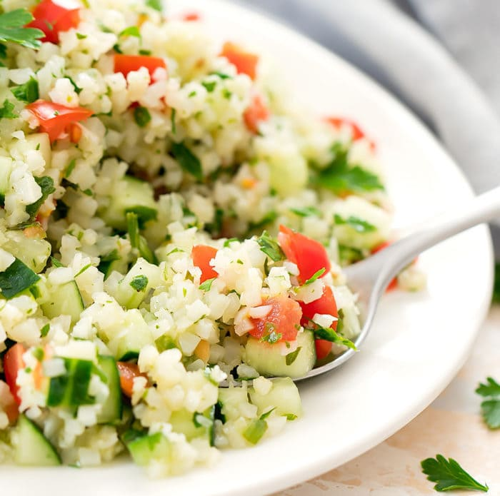 close-up of spoonful of cauliflower tabbouleh