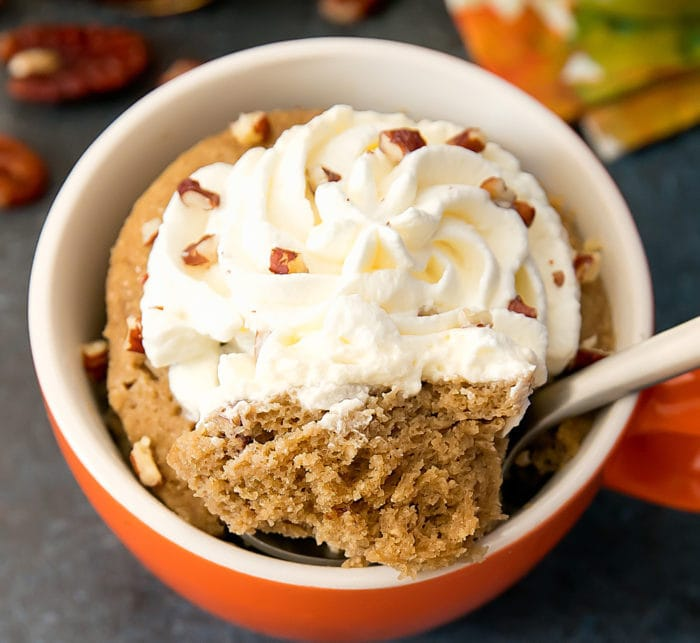 overhead photo of a Maple Pecan Latte Mug Cake with a spoon