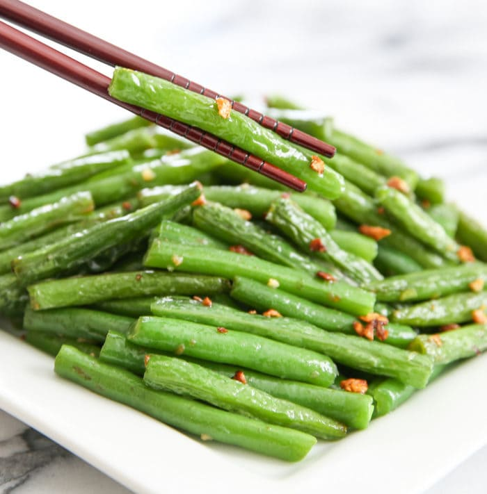 Chopstick holding chinese garlic green bean