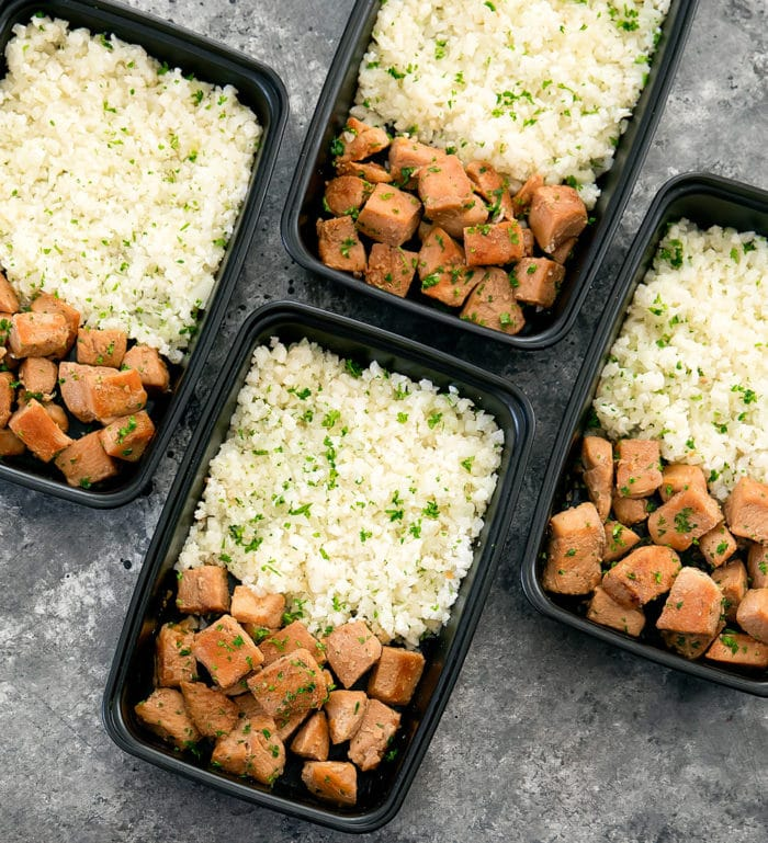 overhead photo of Honey Garlic Butter Chicken with Cauliflower Rice in meal prep containers