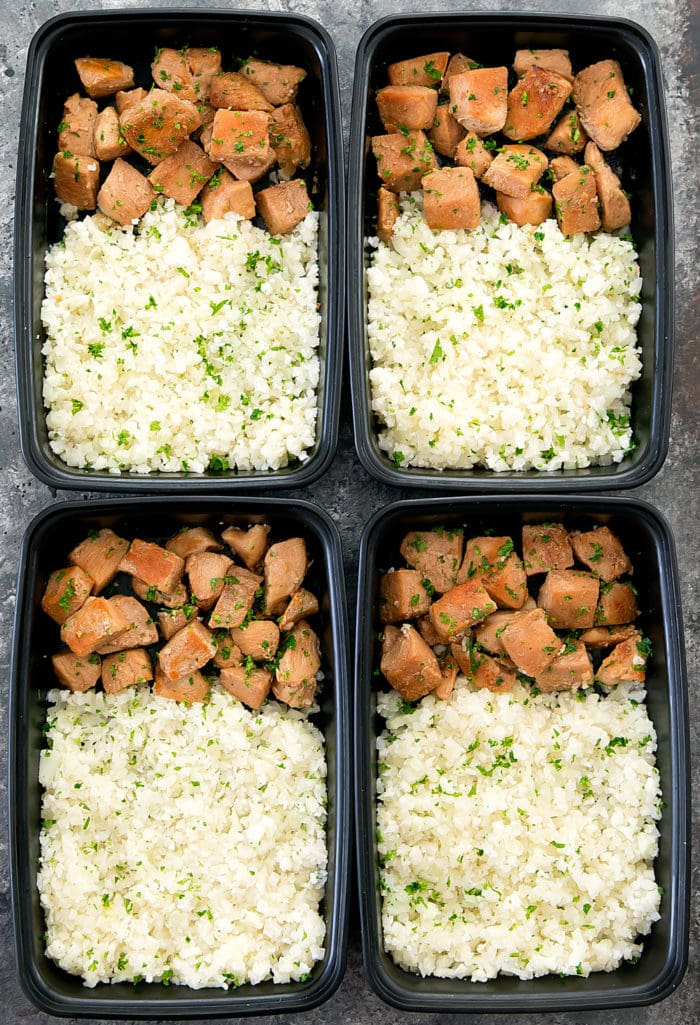 overhead photo of four containers with Honey Garlic Butter Chicken with Cauliflower Rice
