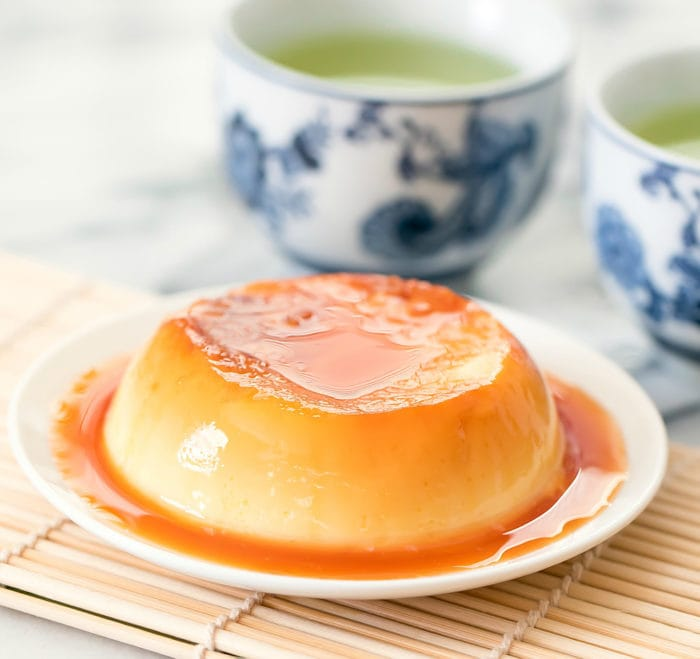 photo of a custard pudding with caramel sauce on a plate