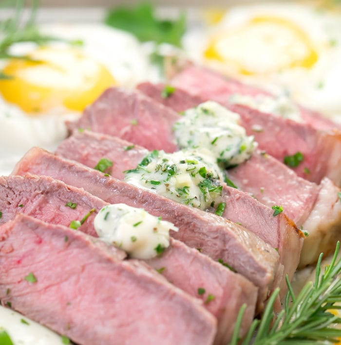 close-up photo of sliced steak with garlic butter