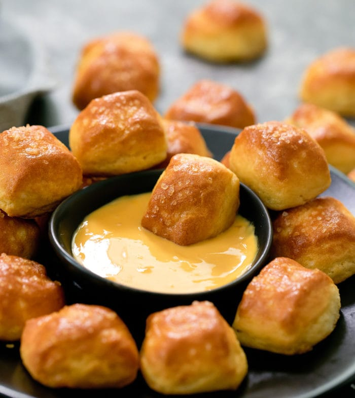 keto soft pretzel bites served in a plate with cheese dipping sauce