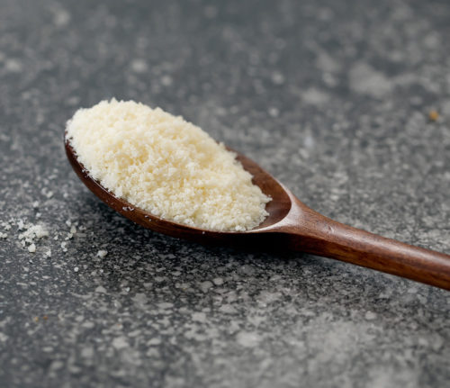 photo of spoonful of finely grated parmesan cheese