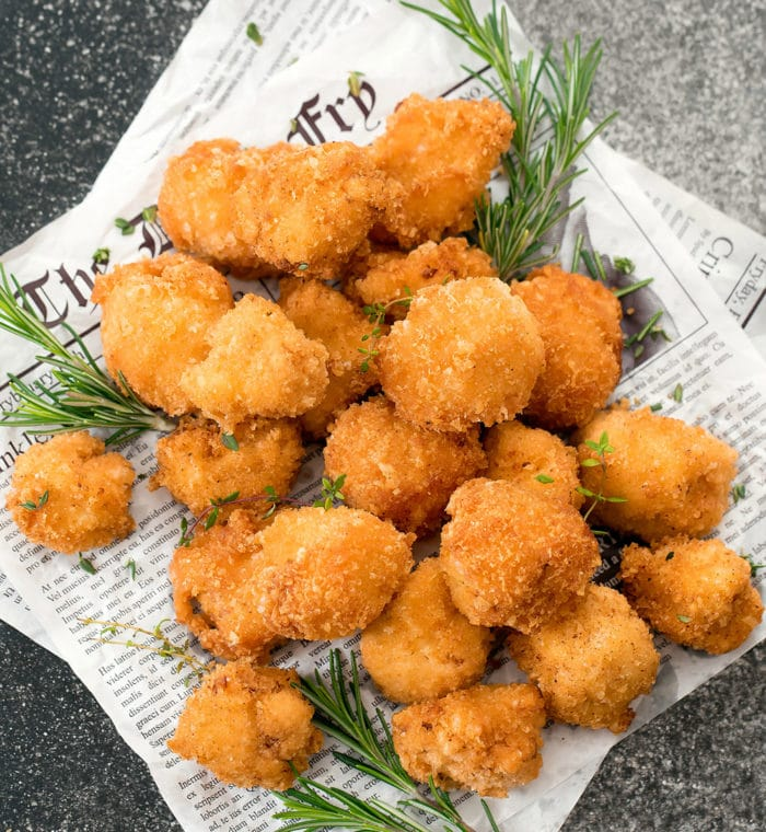 overhead photo of a pile of Crispy Low Carb Keto Cauliflower Bites