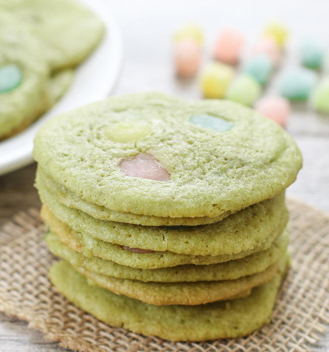 stack of matcha green tea mochi cookies with loose mini mochi in the background