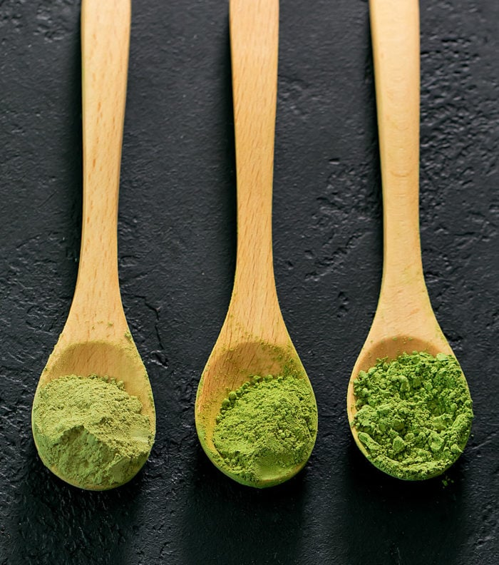 photo of three wooden spoons with matcha powder