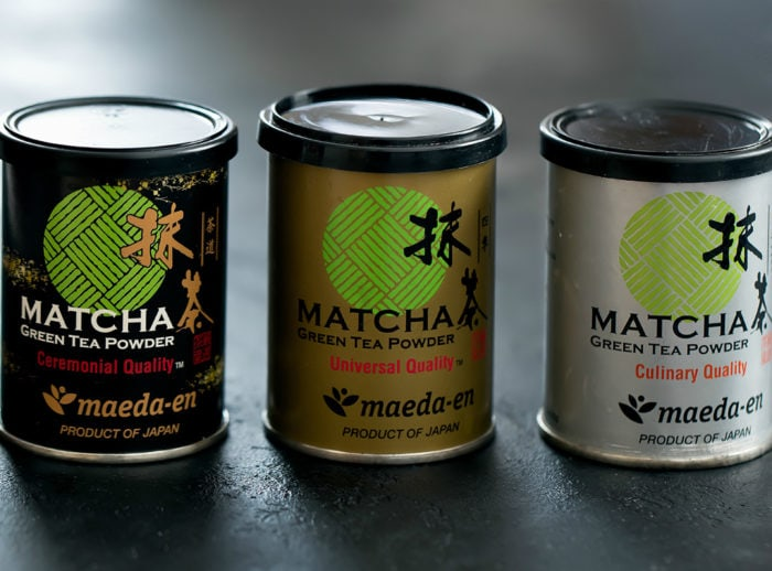 photo of three canisters of matcha green tea powder