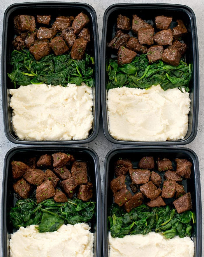 overhead photo of meal prep containers with Steak Bites with Mashed Cauliflower