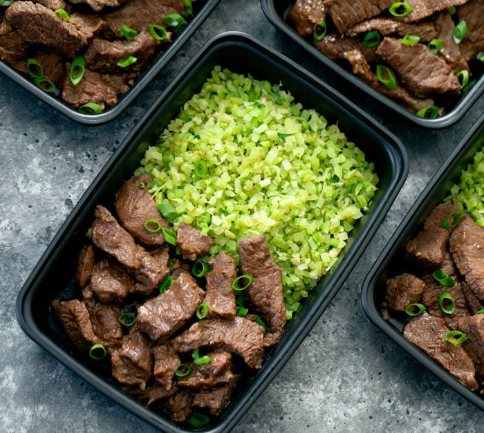 oveherad photo of beef and broccoli rice in a meal prep container