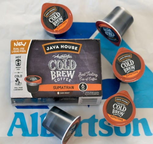 overhead photo of a box of java house coffee pods with coffee pods around it