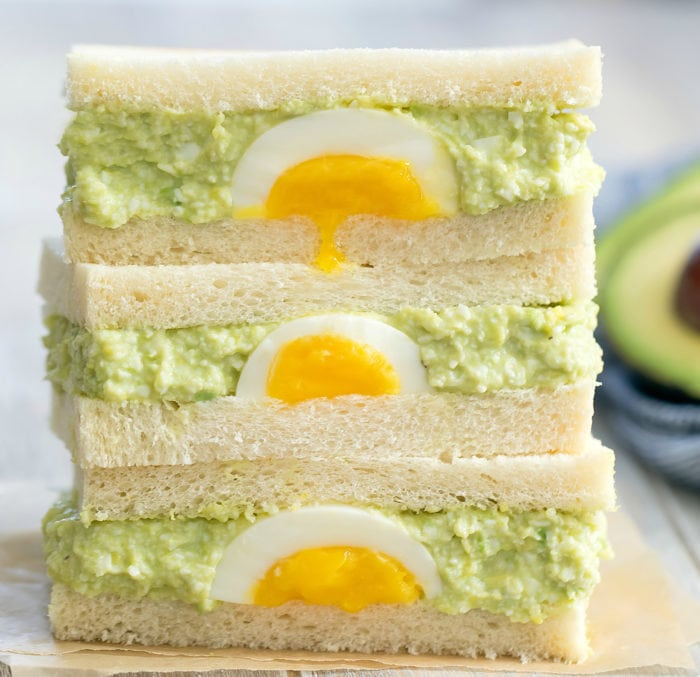 photo of a stack of Avocado Egg Salad Sandwiches