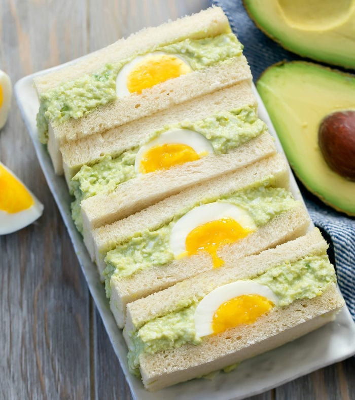 overhead photo of avocado egg salad sandwiches