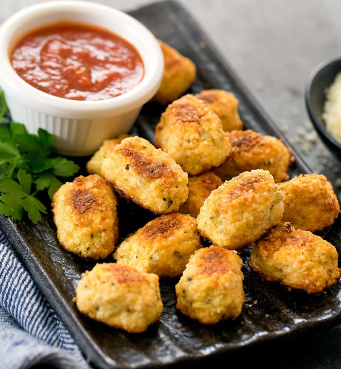photo of a plate of keto cauliflower tots with dipping sauce