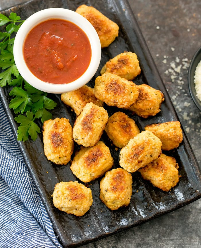 overhead photo of a plate of keto cauliflower tots with a bowl of dipping sauce