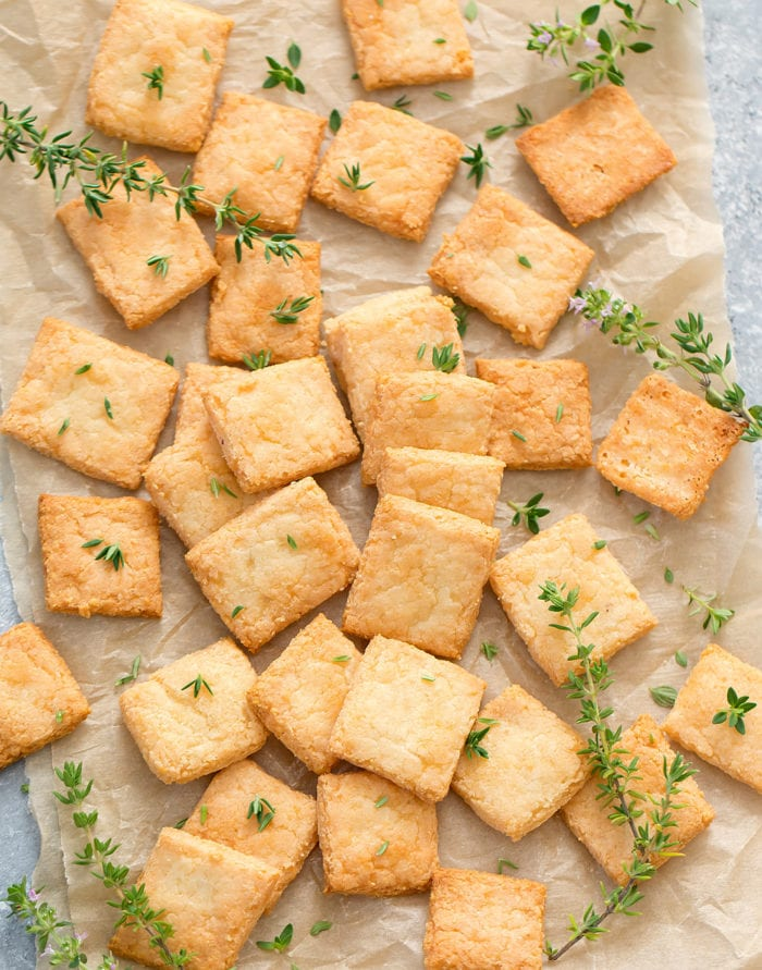 overhead photo of cheese crackers spread out on parchment