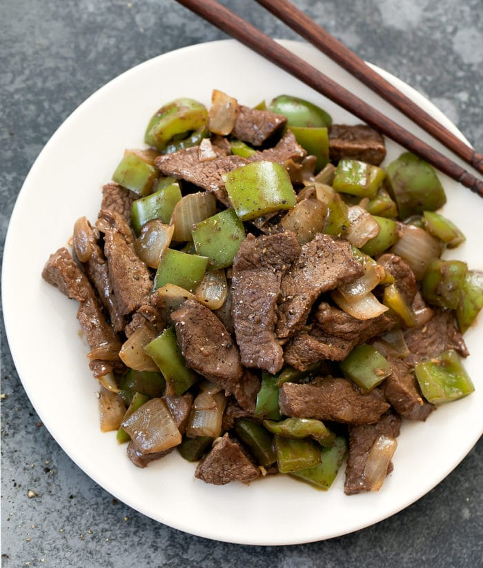 overhead photo of a plate of Black Pepper Beef with chopsticks