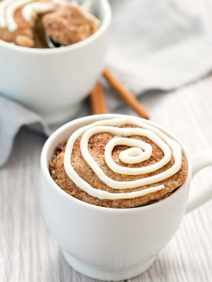 photo of a Cinnamon Roll Mug Cake with cream cheese frosting