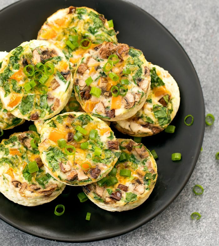 overhead photo of egg muffins stacked on a plate