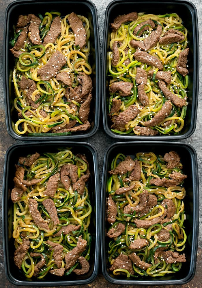 overhead photo of four containers of Garlic Beef Zucchini Noodles