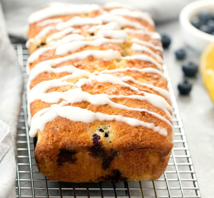 photo of keto blueberry bread drizzled with glaze