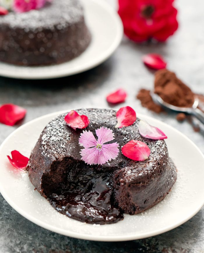 close-up photo of a keto lava cake garnished with flower petals