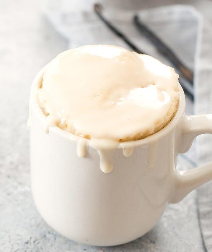 vanilla mug cake topped with vanilla glaze