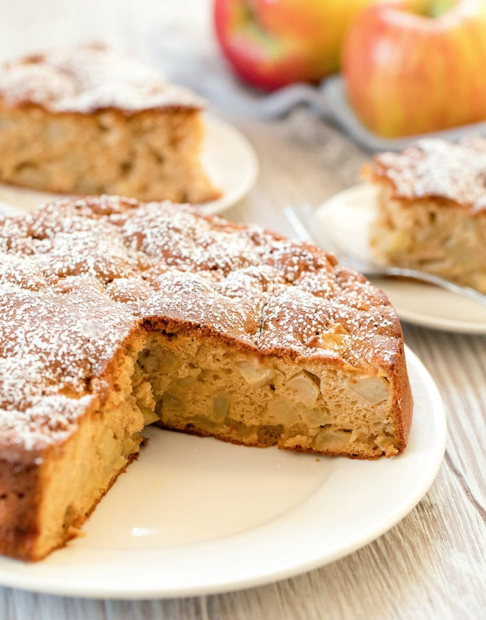 photo of an apple cake with two slices removed