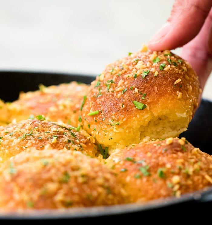 photo of a roll being lifted out of the pan