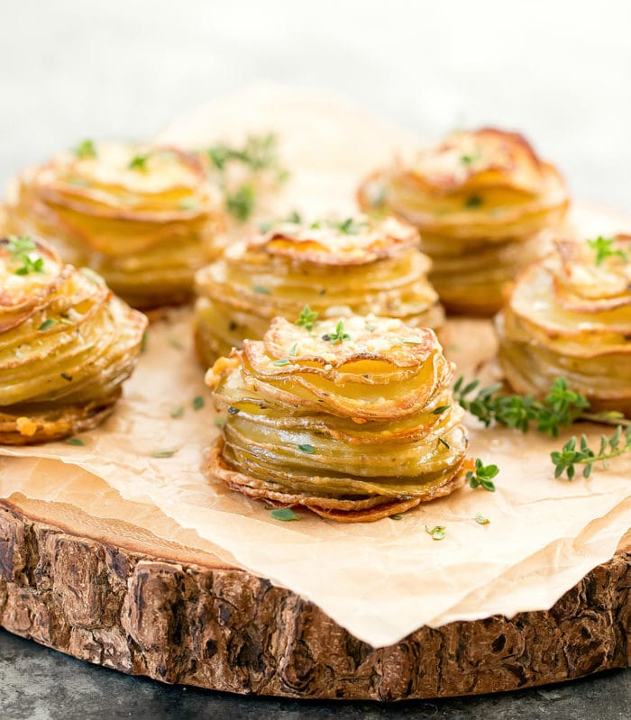 photo of potato stacks on a wooded serving platter