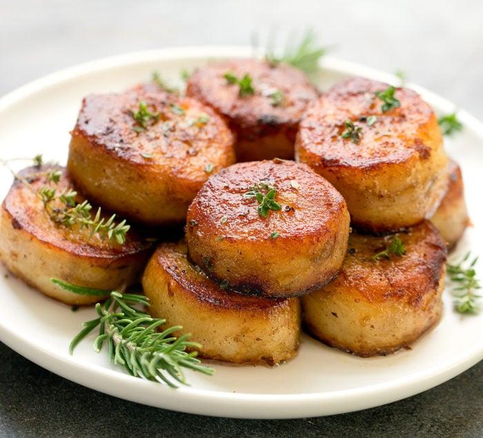 photo of melting potatoes garnished with rosemary